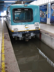 TGM line platform with train in flooded track section.