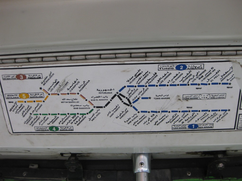 Inside the tram cars there are maps depicting the routes of each line. Note the station names in dual language