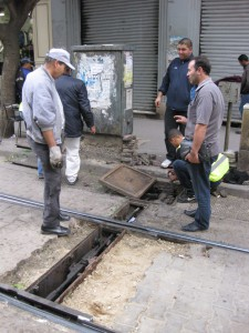Tunis-workmen-changing-point-motor-close-up